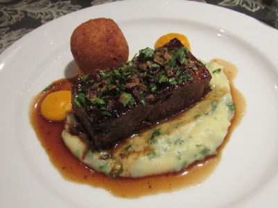 Slow-roast lamb, lamb croquette, colcannon mash, egg-yolk yellow carrot puree
