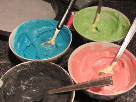 Black, blue, pink and green food colouring