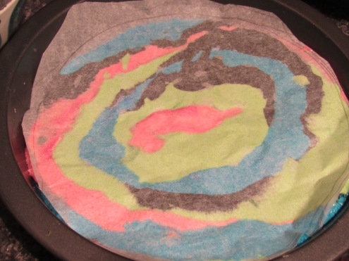 Baking paper over coloured batter